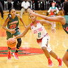Don Knight |  The Herald Bulletin<br /> Anderson's Desiree Barnes brings the ball down court for the Lady Tribe as they hosted the Lawrence North Wildcats on Wednesday.