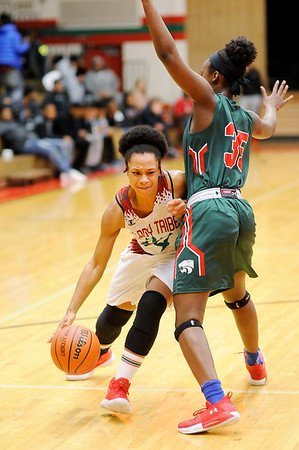 Don Knight |  The Herald Bulletin<br /> Anderson's Alandis Hill drives to the basket as she is guarded by Lawrence North's Justis Odom on Wednesday.