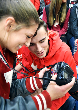 John P. Cleary | The Herald Bulletin<br /> Frankton sophomore Chainey Lowe shows Cameron Hoffman some of the photos she has taken of the Frankton student section before the start of the Frankton- Lapel girls basketball game Friday evening.