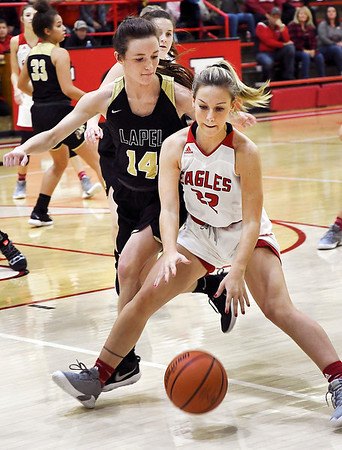 John P. Cleary   The Herald Bulletin<br /> Lapel's Kylie Rich cuts off Frankton's Sierra Southard from driving the baseline during first half action.