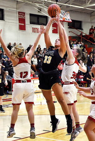 John P. Cleary   The Herald Bulletin<br /> Lapel's Delany Peoples splits Frankton's defenders, Bailey Tucker and Lauryn Bates, as she drives the lane for a shot.