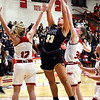 John P. Cleary | The Herald Bulletin<br /> Lapel's Delany Peoples splits Frankton's defenders, Bailey Tucker and Lauryn Bates, as she drives the lane for a shot.