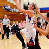 Don Knight |  The Herald Bulletin<br /> Elwood's Gabby Leavell drives into the lane as the Panthers hosted the Liberty Christian Lions on Friday.