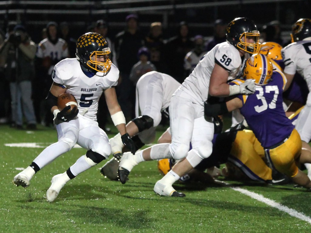 . Randy Meyers - The Morning Journal<br> Olmsted Falls running back Luke Lombardo runs behind the block by John McCabe for a gain during the second quarter on Nov. 17.