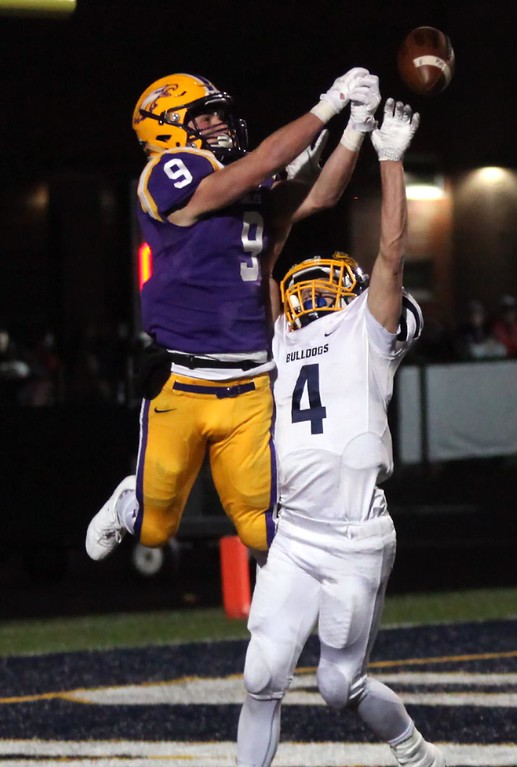 . Randy Meyers - The Morning Journal<br> Josh Jaeckin of Olmsted Falls breaks up a pass in the end zone to Avon\'s David Orlando during the second quarter on Nov. 17.