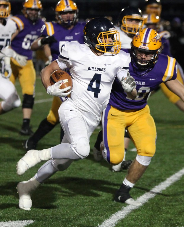 . Randy Meyers - The Morning Journal<br> Josh Jaeckin of Olmsted Falls runs right for a first down against the Avon defense during the first quarter of the Division II, Region 6 final on Nov. 17.