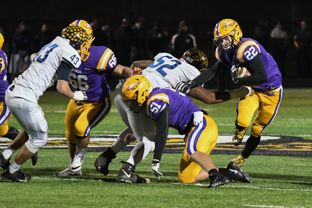. Eric Bonzar�The Morning Journal<br> Avon\'s Nick Perusek (22) cuts his way past Olmsted Falls defender Trae Henderson (52).