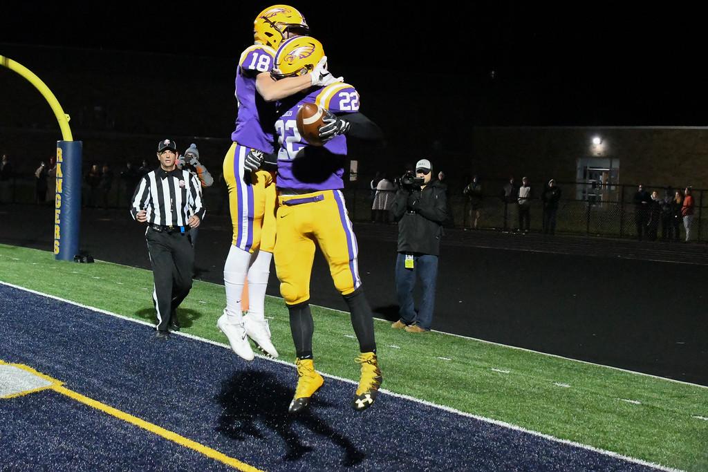 . Eric Bonzar�The Morning Journal<br> Avon\'s Nick Perusek (22)  celebrates his touchdown with wide receiver Matt Kennedy (18).