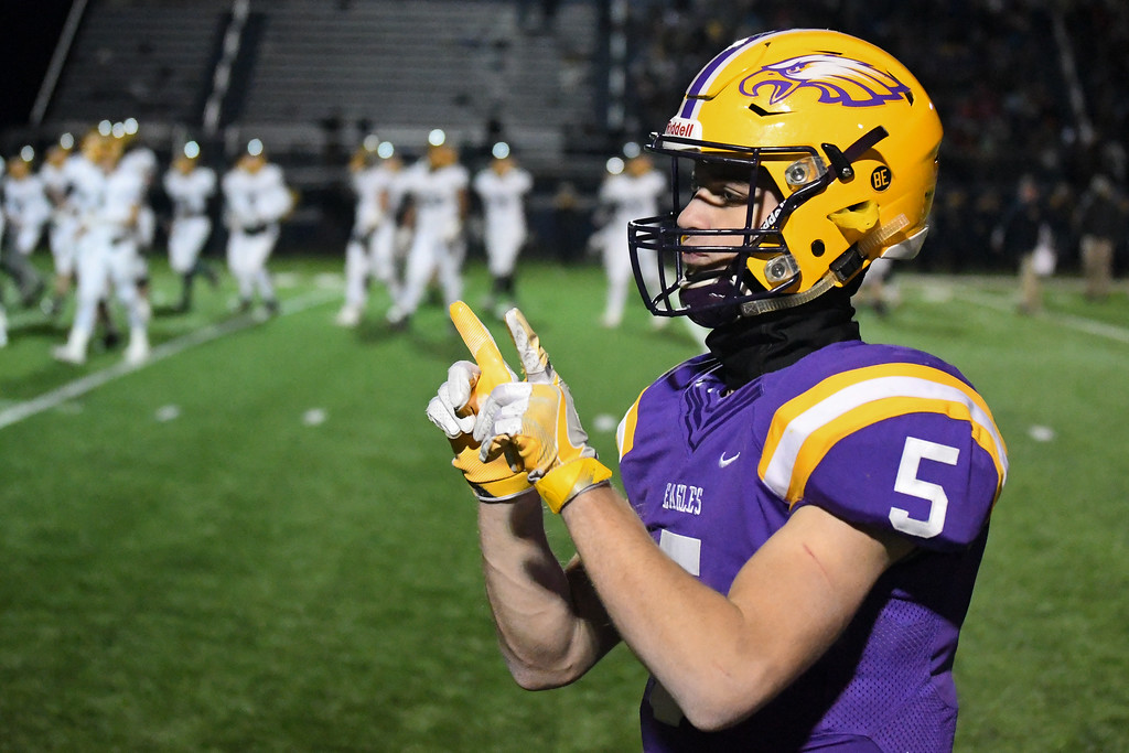 ". Eric Bonzar�The Morning Journal<br> Avon quarterback Ryan Maloy throws up the \""W.\"""