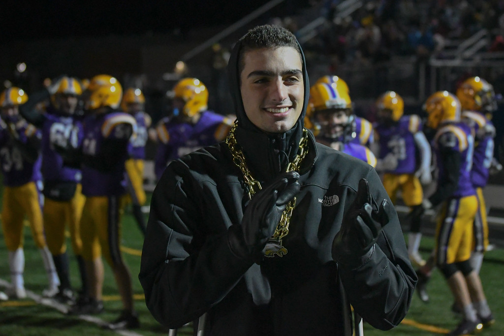 . Eric Bonzar�The Morning Journal<br> Injured Avon tight end Vlasi Pappas applauds his fellow Eagles.