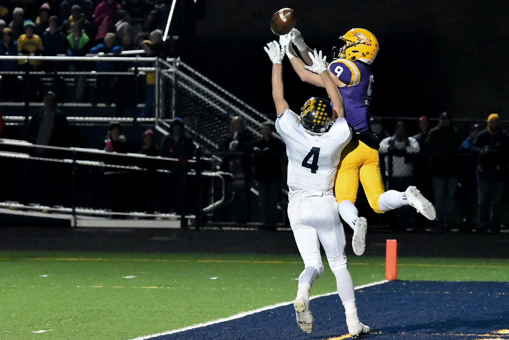 . Eric Bonzar�The Morning Journal<br> Avon\'s David Orlando (9) can\'t come up with the catch as he\'s defended by Olmsted Falls\' Josh Jaeckin (4).