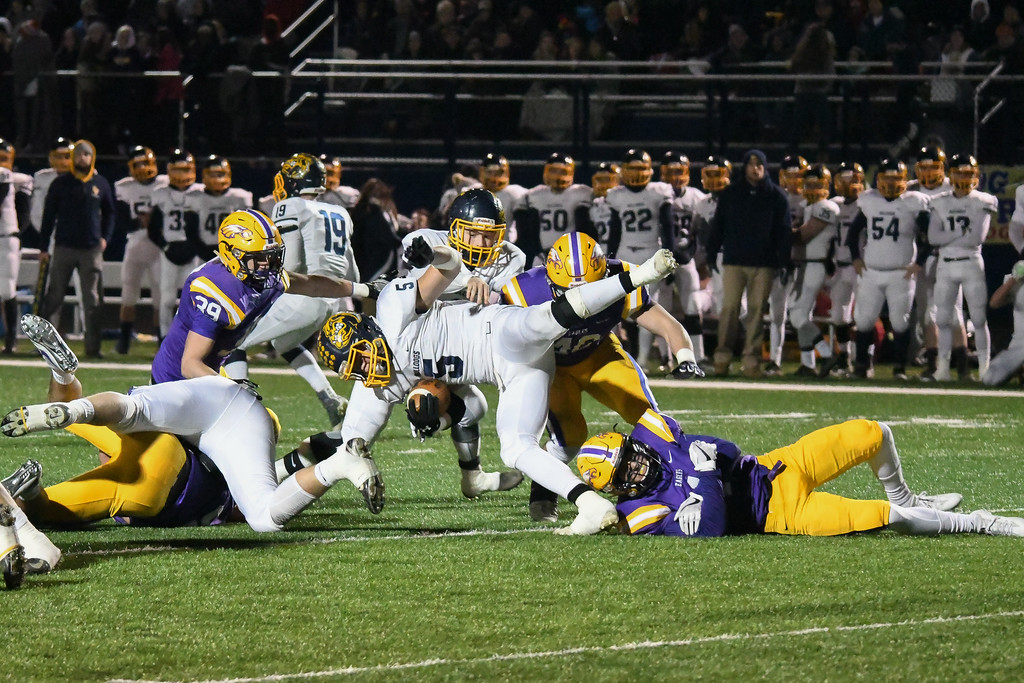. Eric Bonzar�The Morning Journal Olmsted Falls\' Luke Lombardo (5) is tripped up by Avon\'s Joey Lance (1).