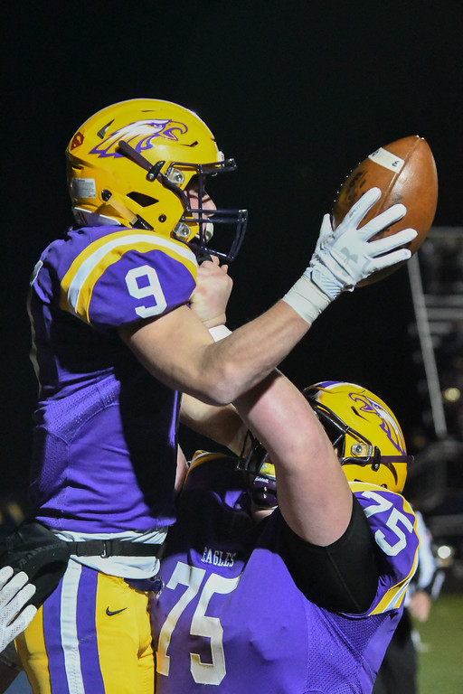 . Eric Bonzar�The Morning Journal<br> Avon\'s Matt Schuler (75) lifts wide receiver David Orlando (9) in to the air after Orlando scores.