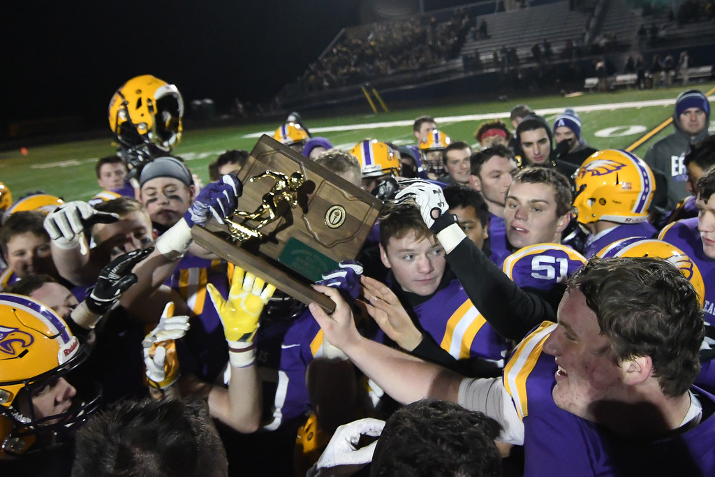 . Eric Bonzar�The Morning Journal<br> The Avon Eagles celebrate their D-II Regional Final Championship at midfield after knocking off the Olmsted Falls Bulldogs, 55-14, Nov. 17, 2017.