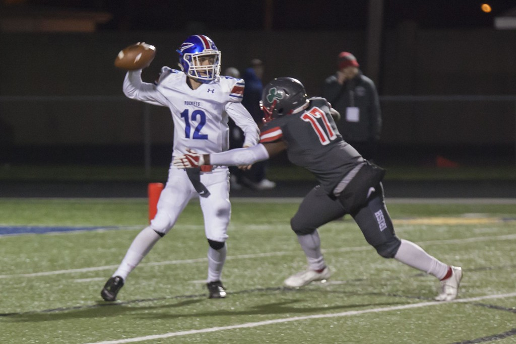 . Jen Forbus - The Morning Journal<br> Toledo Central Catholic\'s Sean Blue moves in on Bay quarterback Connor Shell on Nov. 17.