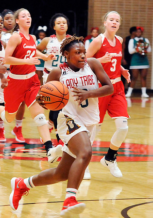 John P. Cleary |  The Herald Bulletin<br /> Anderson's Staisha Hamilton drives to the basket on a fast break against Connersville.