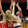 John P. Cleary |  The Herald Bulletin<br /> Anderson's Tiana Ford puts up a shot over Connersville defenders.