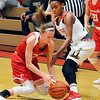 John P. Cleary |  The Herald Bulletin<br /> Connersville's Marley Smith looses control of the ball as Anderson's Tyra Ford closely defends her.