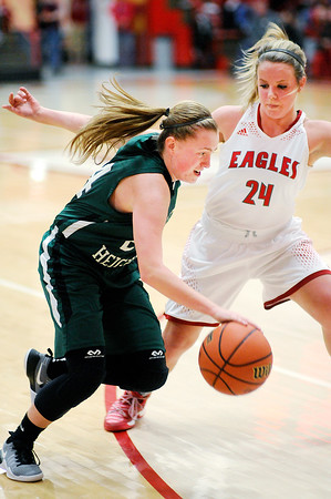 Don Knight | The Herald Bulletin<br /> Pendleton Heights' Maggie Dooley drives as she is guarded by Frankton's Aleyah Rastetter on Saturday.