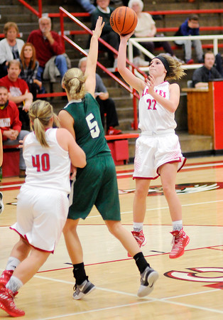 Don Knight | The Herald Bulletin<br /> Frankton's Sierra Southard shoots as she is guarded by Pendleton Heights Ashley King as the Eagles hosted the Arabians on Saturday.