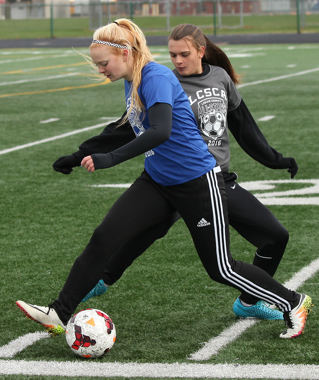 . Randy Meyers - The Morning Journal Bailee Pihlblad of Amherst and Taylor Trbovich of Vermilion battle for the ball near the sideline during the first half of the Lorain County All-Star game at Midview on Nov. 19.