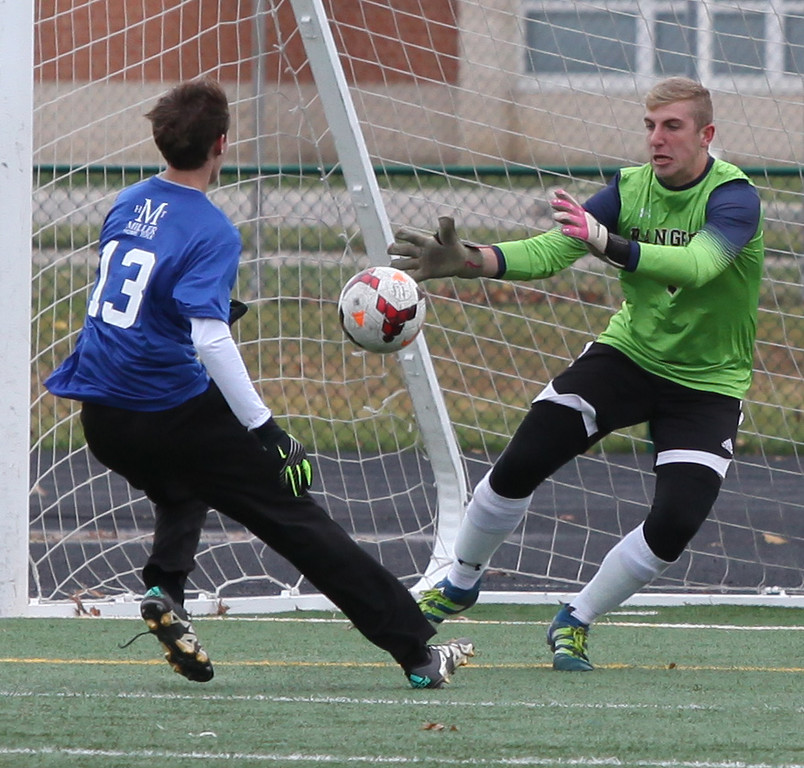 . Randy Meyers - The Morning Journal North Ridgeville goale Kyle Milner saves a shot by Sam Redman of Avon Lake during the 2016 Lorain County All-Star game at Midview on Nov. 19.