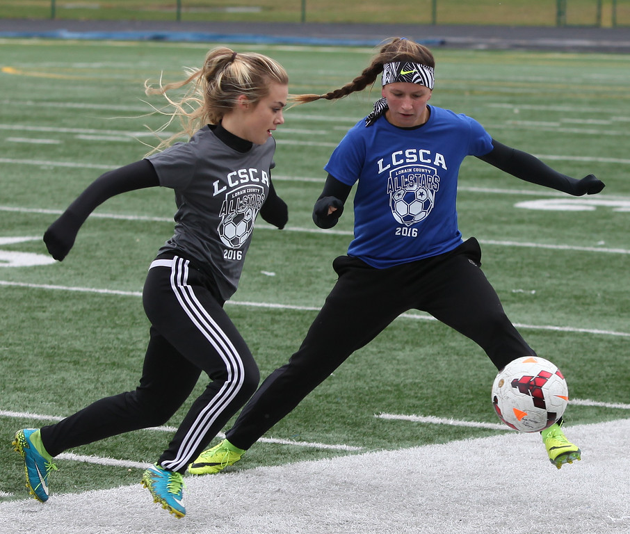 . Randy Meyers - The Morning Journal Brookside\'s Madison Sours tries to kick past Sarah Miller of Amherst during the first half of the 2016 Lorain County All-Star game at Midview on Nov. 19.