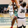 Don Knight | The Herald Bulletin<br /> Anderson's Jesse Sawyer draws a foul from Pendleton Heights' Christian Jones on a fast break on Tuesday.