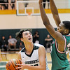 Don Knight | The Herald Bulletin<br /> Pendleton Heights' Damieon Warrum looks to shoot as he is guarded by Anderson's Tyquez Priester on Tuesday.
