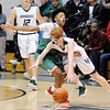 Don Knight | The Herald Bulletin<br /> Pendleton Heights' Zion Cook drives as he is guarded by Anderson's Daveyon Turner on Tuesday.