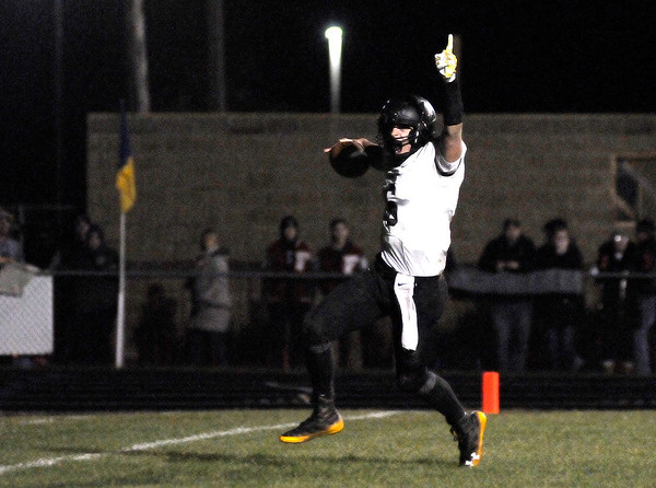 Don Knight | The Herald Bulletin<br /> Lapel quarterback Cole Alexander celebrates as he scores on a 15 yard run with 2:23 left for a 35-27 lead as the Bulldogs faced the Shenandoah Raiders for the sectional championship on Friday.