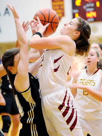 Don Knight | The Herald Bulletin<br /> Alexandria's Blaine Kelly draws a foul from Lapel's Kylie Rich on a drive to the basket as the Tigers hosted the Bulldogs on Wednesday.