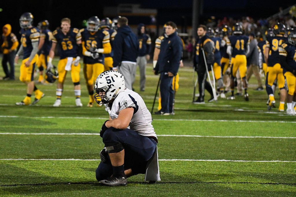 . Eric Bonzar�The Morning Journal<br> Lorain junior Kelvin Torres takes a knee as the Toledo Whitmer Panthers walk off the field after a 31-28 win.