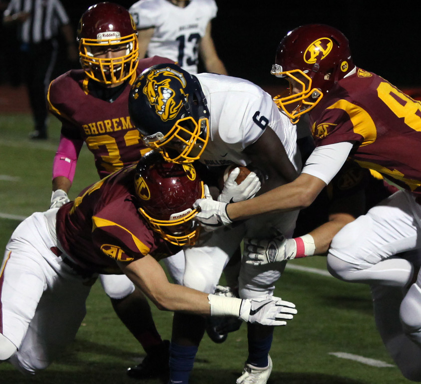 . Randy Meyers - The Morning Journal<br> Michael Howard of Olmsted Falls returns a kickoff for a short gain before he is stopped by the Avon Lake coverage team on Oct. 20.