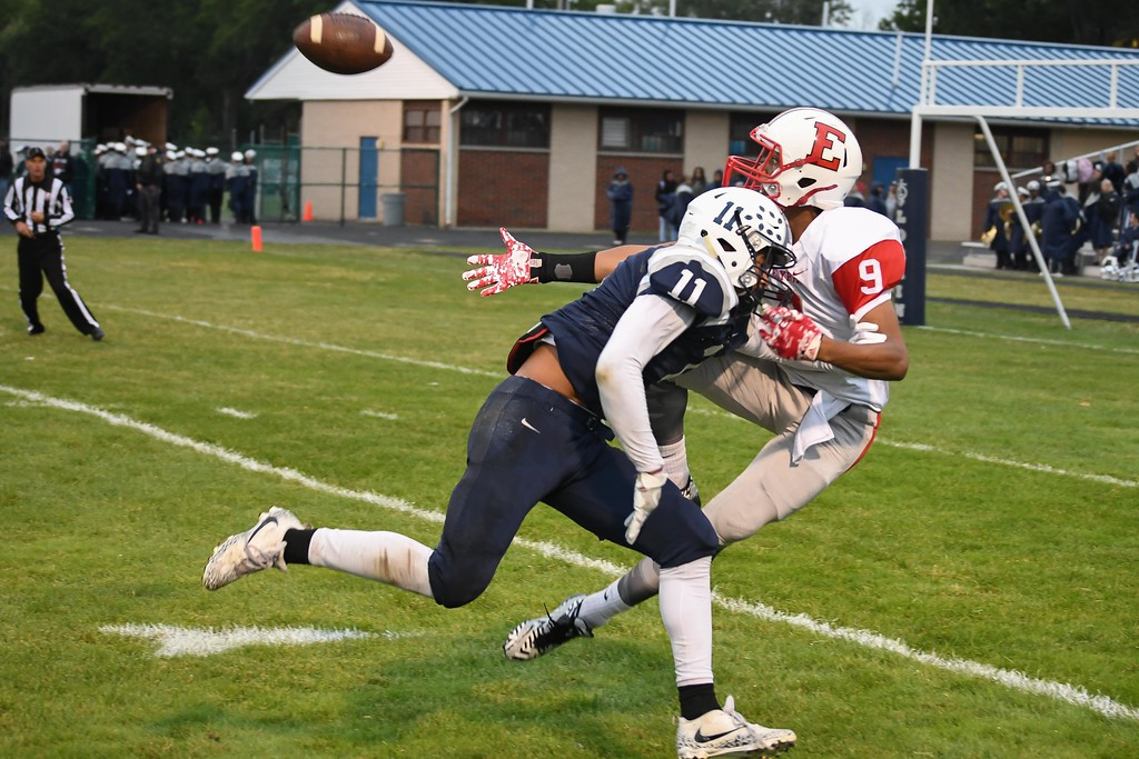 . Eric Bonzar�The Morning Journal<br> Lorain\'s Daylin Dower (11) is called for pass interference on Elyria\'s Izaiah Thomas (9), Sept. 7, 2017.