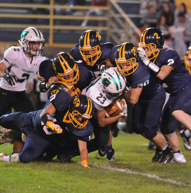 . Paul DiCicco - The News-Herald<br> A swarm of Kirtland defenders bring down Columbia running back Brandon Coleman on Sept. 1.