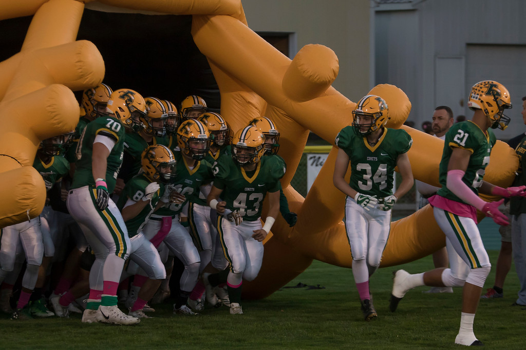 . Jen Forbus - The Morning Journal<br> The Amherst Comets take the field for their showdown with the North Olmsted Eagleson Oct. 13.