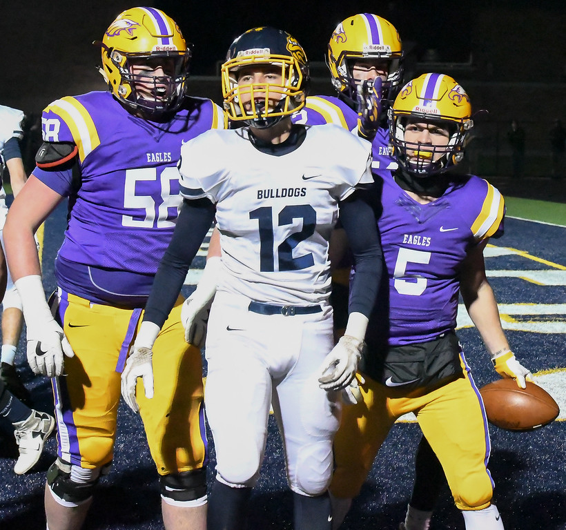 . Eric Bonzar�The Morning Journal<br> Olmsted Falls Michael Dulin (12) is surrounded by Eagles after quarterback Ryan Maloy (5) rushes in for a touchdown on Nov. 17.