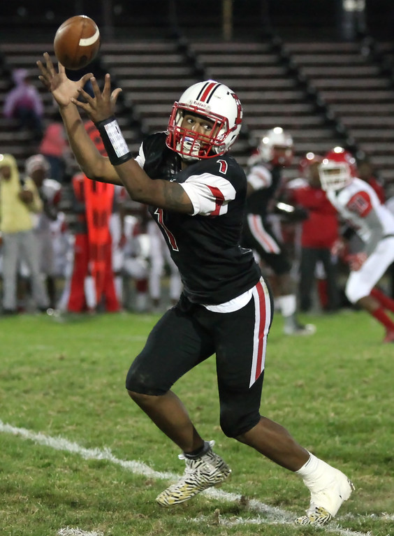 . Randy Meyers - The Morning Journal<br> Elyria quarterback Dontae Beckett bobbles a high snap during the second quarter against Shaker Heights on Sept. 28.