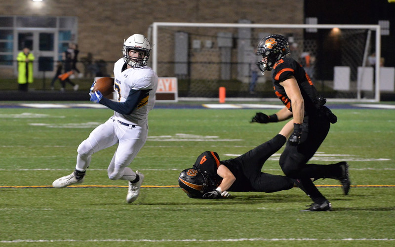 . Aimee Bielozer - The Morning Journal<br> North Ridgeville running back Cade Riley makes a cut up the sideline against North Olmsted on Oct. 6.