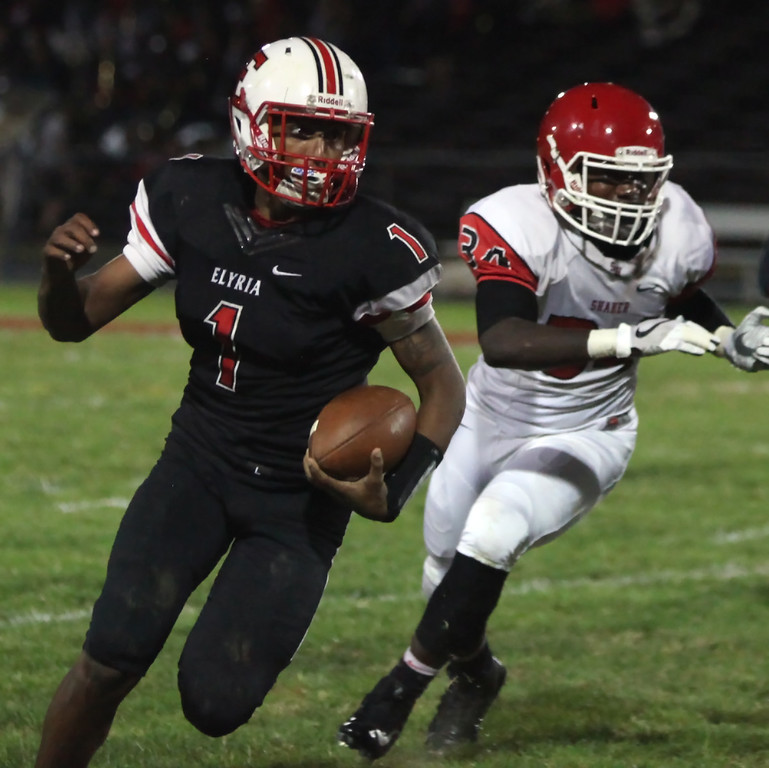 . Randy Meyers - The Morning Journal<br> Elyria quarterback Dontae Beckett turns the corner on the Shaker Heights defense for a big gain during the second quarter on Sept. 28.