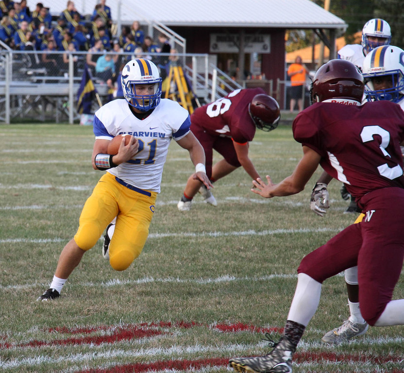 . Nicholas Pfeifer - The Morning Journal<br> Clearview\'s Drew Engle looks for a big gain against Wellington on Sept. 15.