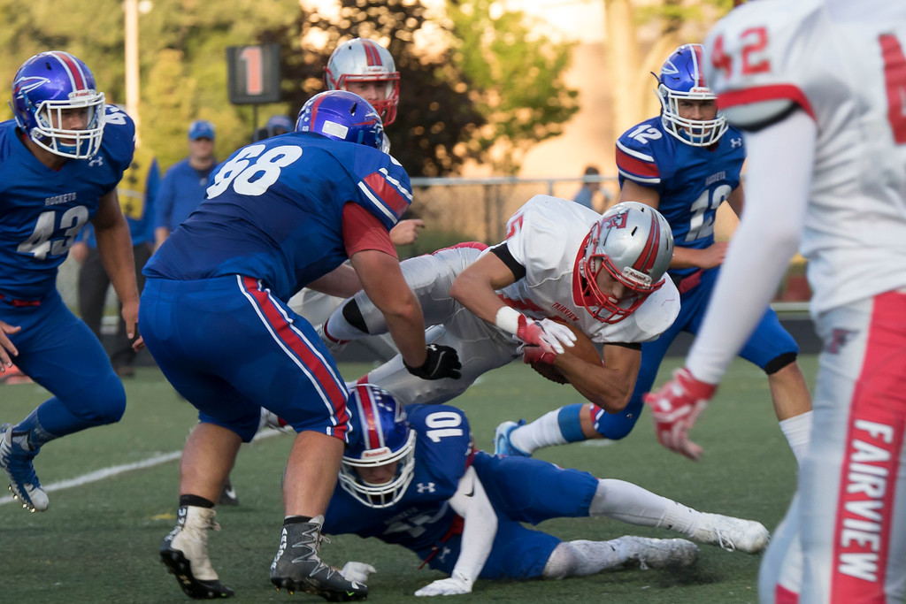 . Jen Forbus - The Morning Journal<br> Fairview running back Jack Provenza goes for extra yards, leaping over Bay\'s Dillon Barry, on Sept. 8.