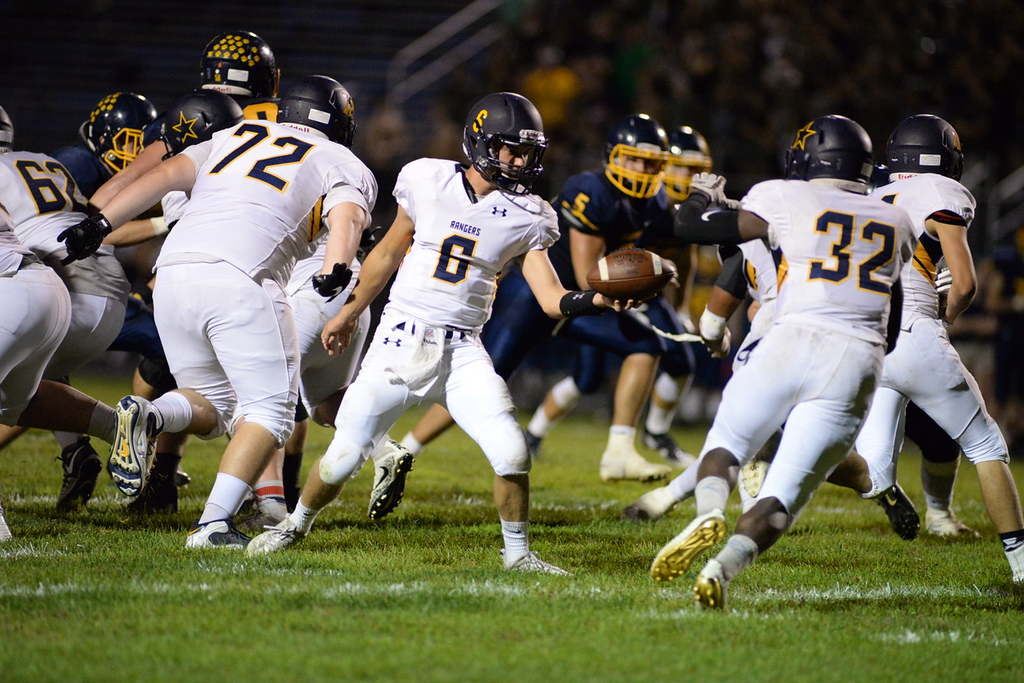 . Aimee Bielozer - The Morning Journal<br> North Ridgeville\'s Matt Steinmetz hands off to Shomari Williams against Olmsted Falls on Sept. 22.