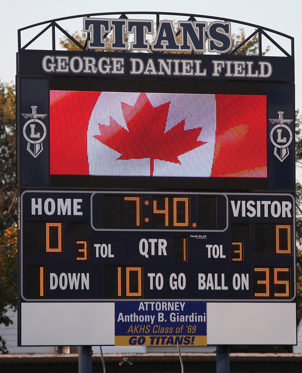 . Randy Meyers - The Morning Journal<br> The scoreboard at George Daniel Field displays the Canadian flag as the Titans maching band played the Canadian National Anthem. Lorain hosted the Clarkson Academy football team from Ontario on Sept. 22.