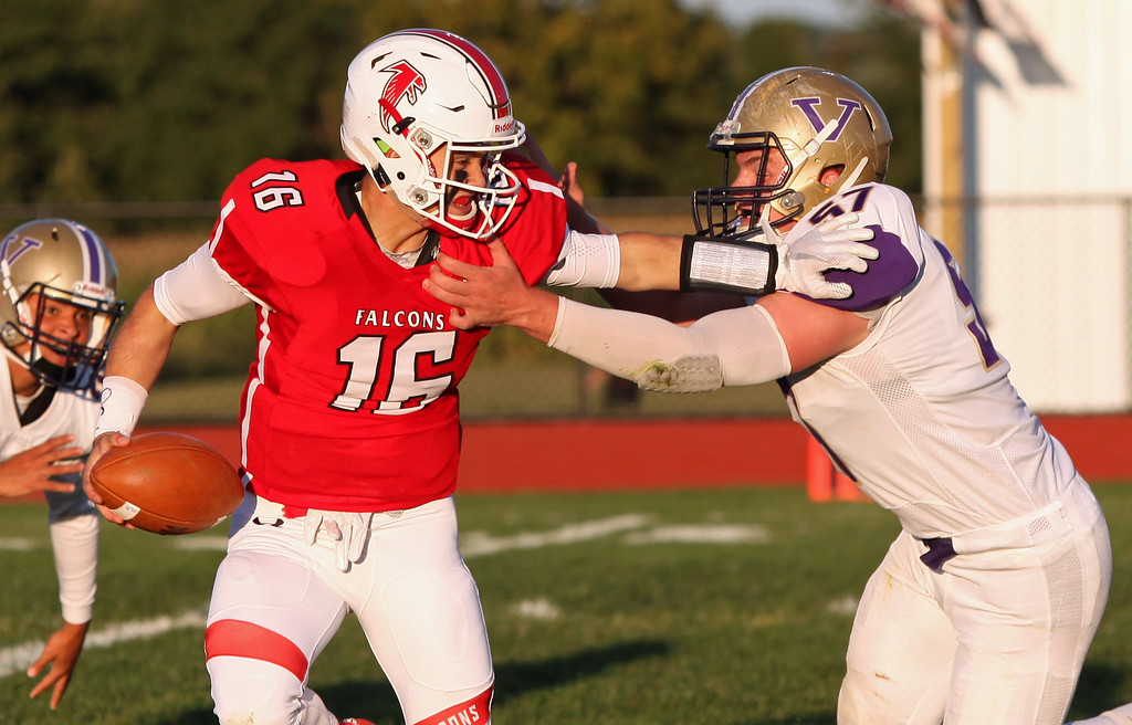 . Randy Meyers - The Morning Journal<br> Firelands quarterback Michael Bansek is pressured by Vermilion\'s Tyler Bath and tackled for a loss during the first quarter on Sept. 8.