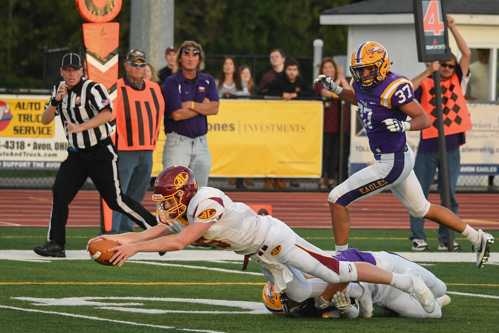 . Eric Bonzar�The Morning Journal<br> Avon Lake quarterback Jack Mikolich (5) stretches his way in to the end zone for the Shoremen\'s only points of the game, Sept. 8, 2017. The Avon Eagles beat Avon Lake 31-6 in their Southwestern Conference match-up.