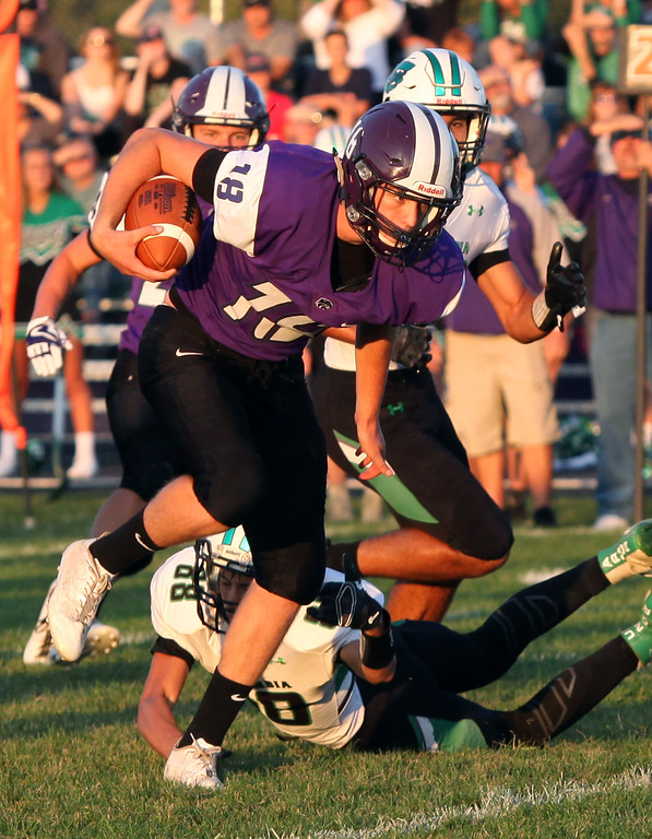 . Randy Meyers - The Morning Journal<br> Keystone quarterback Bobby Weber breaks a tackle attempt by Adam Ross of Columbia for a big gain on Sept. 15.