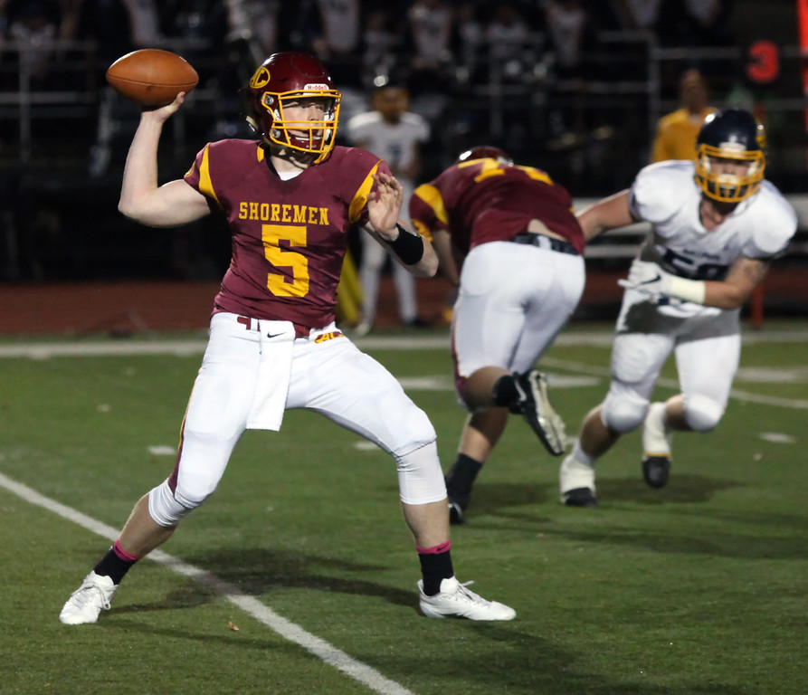 . Randy Meyers - The Morning Journal<br> Avon Lake quarterback Jack Mikolich throws downfield against Olmsted Falls during the first quarter on Oct. 20.
