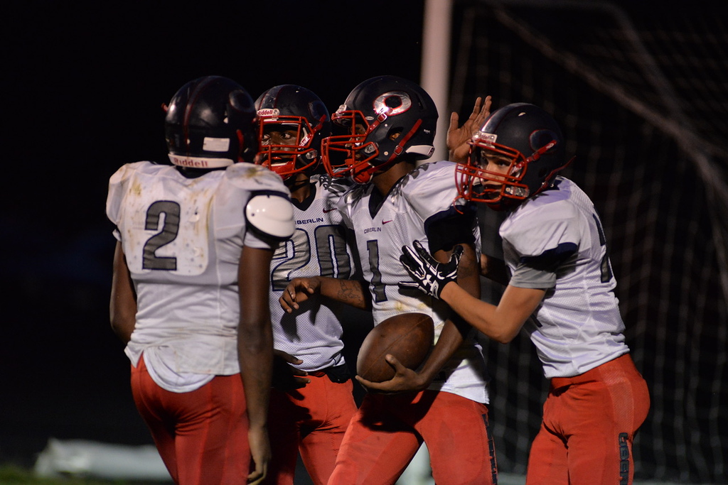 . Aimee Bielozer - The Morning Journal<br> Oberlin\'s Justin Smith (1) celebrates his touchdown against Brookside with his teammates on Sept. 15.